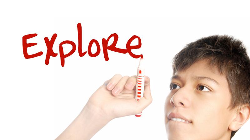 young boy writes explore